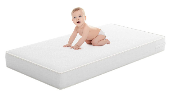 baby on crib mattress